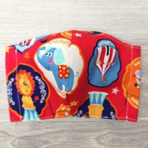 masque pour enfants au thème de cirque avec lion, éléphant et souris. Élastique derrière les oreilles avec un noeud