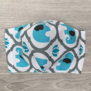 masque enfant avec motifs d'éléphant bleu avec élastiques ajustable et espace pour un filtre Cloth Face Coverings elephant to Help Slow the Spread. Made in Quebec. Two thicknesses of cotton fabric. With a pocket to insert a filter.