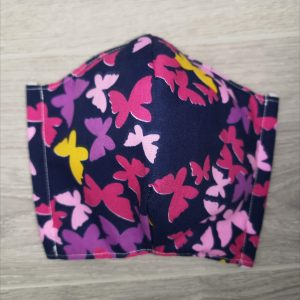 Cloth Face Coverings to Help Slow the Spread. Made in Quebec. Two thicknesses of cotton fabric. With a pocket to insert a filter. With butterfly pink on.